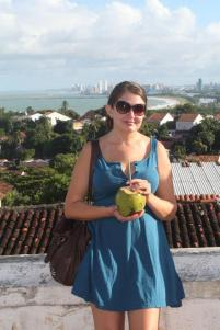 Enjoying fresh coconut water as I explore Olinda.