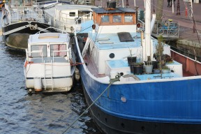 Amsterdam has 2,500 houseboats ranging from small, simple vessels to floating luxury homes. I stayed on the small boat on the left during my visit.